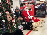 Myla and Alan with Santa and their furry family